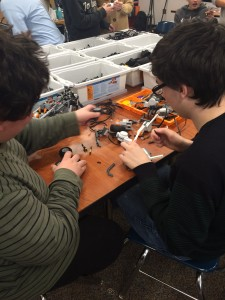 Two freshmen are having fun building their own custom robots.